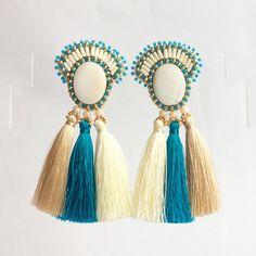 A personal favorite from my Etsy shop https://www.etsy.com/listing/540754816/gold-blue-tassel-earrings-beaded-long