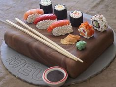Sushi cake with chopsticks and wasabi and ginger