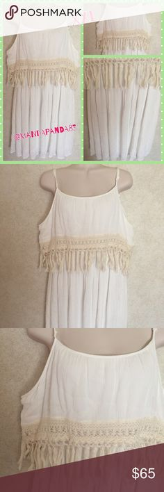 Maurices Boho Fringe Dress NWT  This dress is beautiful! It's classic with boho accents; mainly the fringe upper. The dress is white and fringe is beige/tan. The straps are adjustable. Stunning dress! Measurements upon request for serious buyers only, please. This brand tends to run large. Thank you! Maurices Dresses