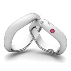 Would fit us perfectly and blow our plain bands out of the water     Matching Wedding Bands: Curved Diamond and Ruby Rings in 14k White or Yellow Gold. This matching wedding ring showcases his and hers wedding bands set in 14k white gold sandblast finish bands studded with diamonds and ruby. Perfect wedding set as couple rings for celebrating love.