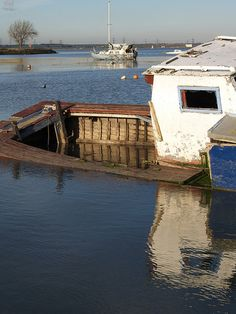Wrecked cabin cruiser Sharps Green Bay on the Medway