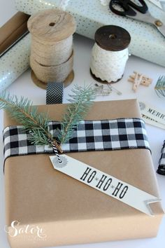 Vintage Glam Christmas Gift Wrap - Holiday gift wrapping ideas using black and white buffalo check ribbon with fresh greens - Satori Design for Living