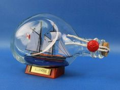 Bluenose Sailboat in a Bottle 7 - Decorative Ship In A Glass Bottle - Model Ship In A Bottle - Nautical Decor... - List price: $19.99 Price: $12.99