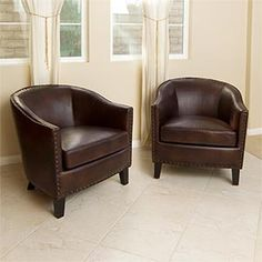 Very masculine espresso brown barrel chairs perfect for someone in waiting just like we are when we go to see him in his office...