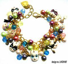 A Venetian Carnival charm bracelet with handmade faces by Leandra Holder