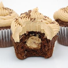 Chocolate-y buckeye cupcakes with peanut butter ball filling.