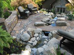 jardin de rocaille avec une murettes en pierres