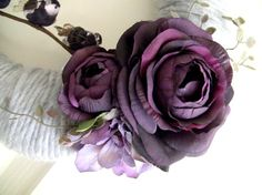 yarn-wrapped wreath with purple silk flowers by forthehome on etsy $35
