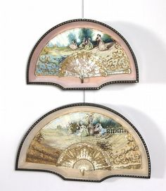 A near pair of framed Victorian hand painted fans,