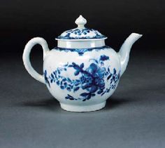 1758 A Worcester blue and white globular teapot and cover  painted with the 'Mansfield' pattern of flowers below diaper panel and scroll borders, painter's marks, circa 1758 -- 11cm. high Christies lot47