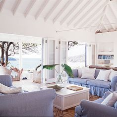 Ocean Blues    Sea-inspired hues are a foolproof choice that lends successful results. This classic blue-and-white palette enhances the surrounding views and provides a relaxing feel for this indoor/outdoor escape.
