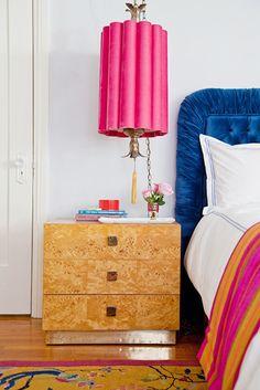 burl wood nightstand side table, pink Hollywood Regency pendant, blue velvet headboard, and Oriental rug // retro bedrooms