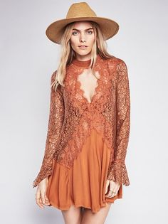 Secret Origins Pieced Lace Tunic | Romantic lace and crepe pieced tunic with a swingy silhouette. Front and back keyhole cutouts with mother of pearl button closures at nape and fluted bell cuffs. Sheer lace top and sleeves with crinkly crepe skirt.
