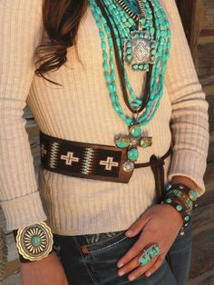 Stacking necklaces, western, Native American belt, silver, on long sleeve sweater type shirt.