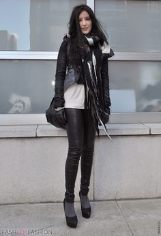 Street style – black outfit with leather pants, white t-shirt, big scarf and gloves with chain details.