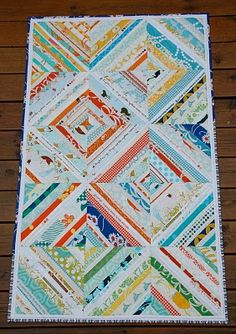 """A second challenge quilt finished this month; my """" xoxo """" using selvage from favorite fabrics. The blocks are sewn on to a cloth foundatio. Diy Quilting Projects, Quilting Designs, Sewing Projects, Quilting Ideas, Quilting Board, Quilt Design, Sewing Ideas, Scrappy Quilts, Mini Quilts"""