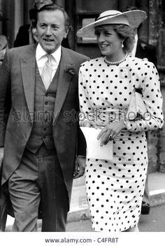 Princess Diana with David Frost take an imromptu walk through the streets of Arundel after attending wedding.