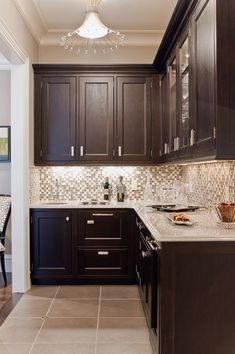 Dark cabinets, light counters & beige walls.  Like the backsplash too!