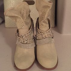 Blinged out boots!  Never worn! Super cute and oh so sparkly. Still have the tags on the bottom. Off white/light tan color Buckle Shoes Ankle Boots & Booties