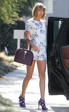 Taylor Swift is perfection in an adorable floral combo and bold, blue heels!