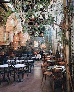 PlantFilled Restaurants Around the World Tips For Decorating With Greenery is part of Bar design restaurant Does your plant collection need a refresh We& feeling inspired by these 11 lush restau - Design Bar Restaurant, Decoration Restaurant, Deco Restaurant, Rustic Restaurant, Restaurant Lighting, Outdoor Restaurant Patio, Veggie Restaurant, House Restaurant, Restaurant Ideas