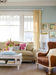 Couch in front of window...this is my wall color...love the colors in general and the ferris wheel pic