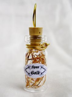 Spun Gold Fairy Tale Bottle Pendant by FairytaleStore on Etsy, $7.00