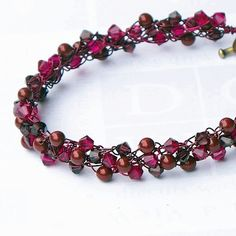 I like these colors, and the effect of the 'bicone' Swarovski type beads on the overall texture of the bracelet.