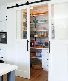 I love this double sliding bard door situation for a pantry!