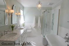 master bath with sherwin williams sea salt paint, pedestal tub, white subway tile, carrera via www.goldenboysandme.com