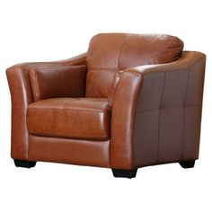 Wrapped In Saddle Brown Leather And Highlighted By Square Tufts, This  Handsome Arm Chair Brings A Cozy Touch To Your Library Or Living Room.