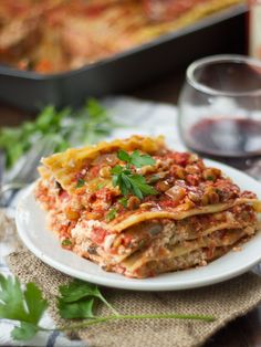 This hearty vegan lasagna is made with layers of noodles, rich cashew ricotta and hearty mushrooms and lentils simmered in spicy tomato sauce.