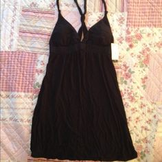 Black sleeveless dress or beach coverup NWT New with tags. Black dress. Size small. Light weight. Has light removable padding in the top. Rampage Dresses Mini