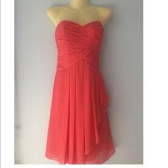 Davi's Bridal short crinkle dress Coral David's Bridal dress in size 8. Strapless, sweetheart neckline is flattering. Fully lined, back zip, dry clean. Poly. Style F14847 David's Bridal Dresses Strapless