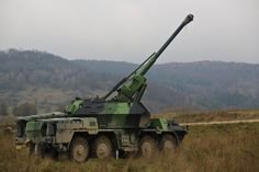Czech Republic army soldiers from 1st and 2nd Platoon Field Artillery maneuver a DANA 152mm self-propelled gun-howitzer vehicle into firing position while conducting a simulated fire mission during exercise Combined Resolve