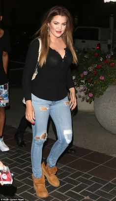 Festival style: Khloe Kardashian dressed in a pair of ripped jeans to watch Kanye West per...
