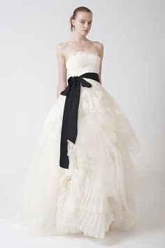 Strapless ballgown with floating multi-layered lace applique, softly tucked skirt and swirling pleated organza insert