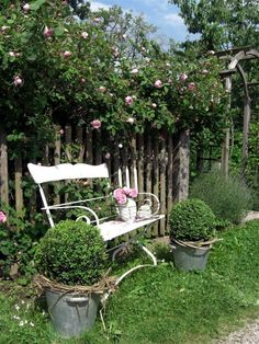 Like the ideas here....the ironstone in the wire basket and the buckets with the grapevine wreathe around the boxwood plant