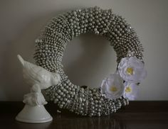 Wreath made from Mardi Gras beads and spray painted. Love this.