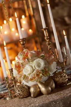 Love the gold fruit and candlesticks. Would love a mix a fake, gold peaches and real peaches on the table.