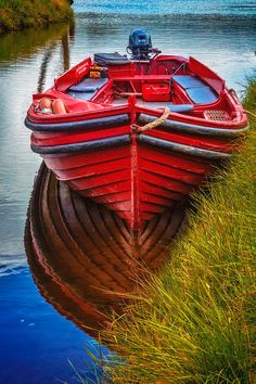 Little Red Boat On The River is a photograph by Debra and Dave Vanderlaan. A bright red wooden rowboat, sits idly in the cool clear waters of the bay at Killarney, ready to cruise out into the lakes around the islands... Interesting patterns in the reflections of the bottom of the boat catch the eye in this pretty scene captured in the harbor below the Macgillycuddy Reeks, Ireland's highest mountain range near the Gap of Dunloe. Source fineartamerica.com