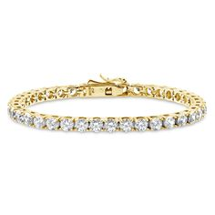 This tennis bracelet is a must-have for every woman. No matter the style, this simple and radiant bracelet will be your perfect outfit addition. Made of yellow gold plated fine 925 sterling silver. Set with round cut Swarovski zirconia (4mm) in 4-prong setting. 6.5 inch (9.75 ct.tw), 7.5 inch (11.25 ct.tw). Box with tongue and safety.