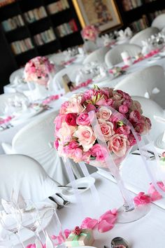 flowers in a vase with scattered petals. maybe pretty on a mirror? and instead of ribbon use some strung pearls?