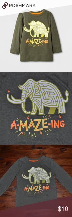 """New Cat & Jack Green Long Sleeve Graphic T-Shirt He'll be ready for any adventure when he wears this Long-Sleeve T-Shirt from Cat & Jack. This graphic T-Shirt features a maze in the shape of a wooly mammoth with the phrase """"A-MAZE-ING"""" in yellow and orange letters below. Pair with jeans or jogger pants and he's all set for fun and games.   size 12M new without tags color: olive green  More kid's clothes in my posh closet @cjrose25. Bundle your likes for a discount & save on shipping!! Cat…"""