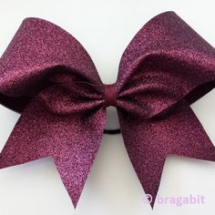 Maroon glitter cheer bow. I can put your team name on it or make one side other color or chevron. Contact me for more information and team discounts.