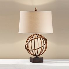 This light firenze gold table lamp with a dark walnut base, comes complete with a dark walnut tan linen shade. Click to shop for yours.
