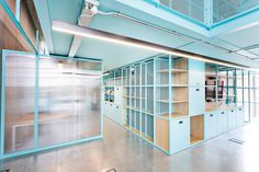 The interior design by Brinkworth features a material palette of birch plywood and linoleum, as well as colourful powder-coated steel structures that function as room dividers and storage spaces. Minimal Home, Zaha Hadid Architects, Religious Architecture, Ceiling Height, Steel Structure, Creative Industries, Building Design, Second Floor, Ground Floor