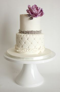 Very pretty little wedding cake with silver beading and a lovely lavender peony topper.  ᘡղbᘠ