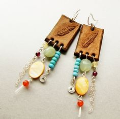 Tooled leather earrings, carved feather, sterling silver and gemstones by Noria Elements