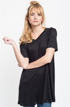 We're obsessed with tees that keep their shape while still having a cool drape, like this fresh (and endlessly versatile) basic tee. We love the super-flattering, everyday wear of these tees.COLORS BlackHeather GreyIvoryBluePeachToffeeBerrySIZES (This garment runs true to size) Small 0-4Medium 6-8Large 10-12X-Large 14-16Model is wearing a size Small95% Rayon, 5% Spandex.